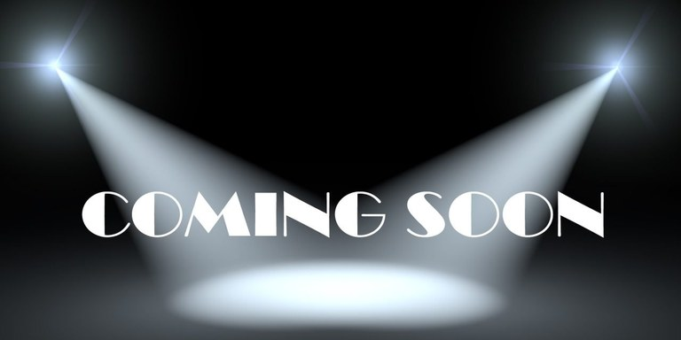"Black background with 2 stage lights from the side and the words ""Coming Soon"""